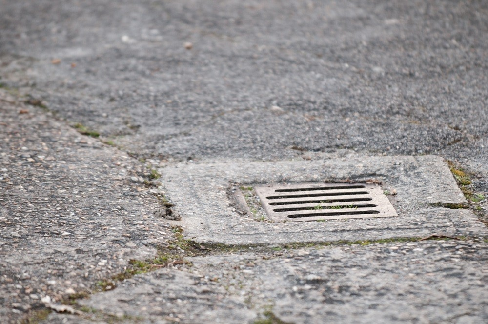 how to unblock a drain outside